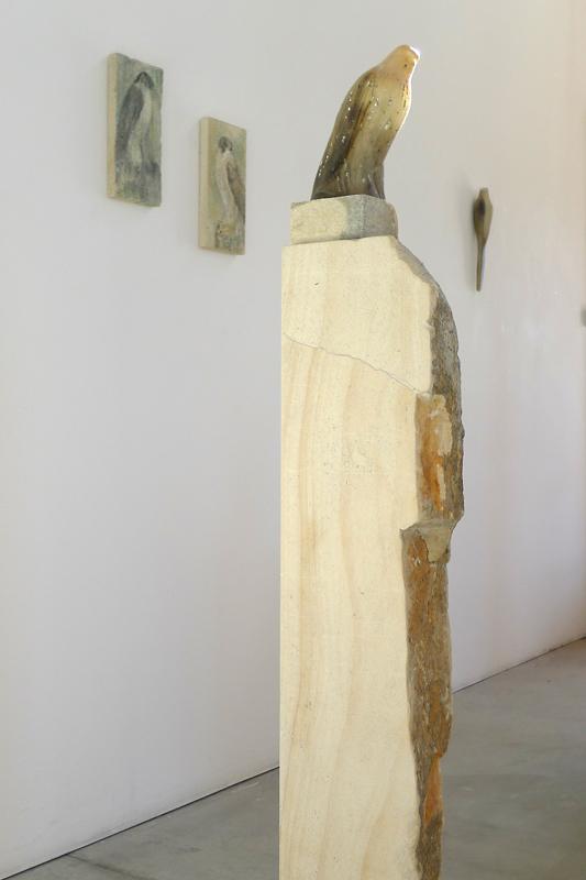 """Cave Bird,"" 2013 Hand blown pigmented glass & beau maniere limestone 71 x 8 x 12"