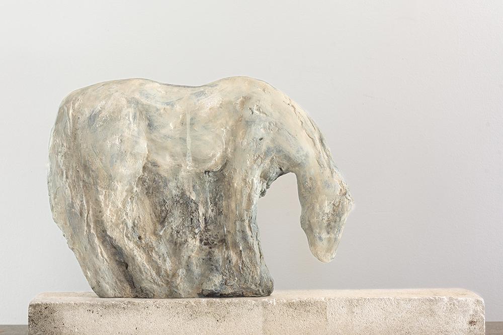 """Bronze Cash Cutout,"" 2016 Cast bronze with unique patina on limestone 16 x 26 x 4 inches"