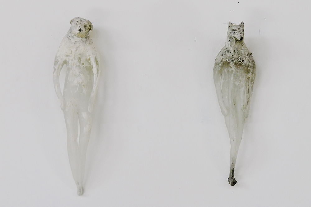 Rook Buddhi (left), 2013, Hand blown pigmented glass and marble, 9 x 5 x 4 inches  Bronze Buddhi (right), ed. of 6, 2016, Cast bronze with unique patina, 18 x 5 x 4 inches