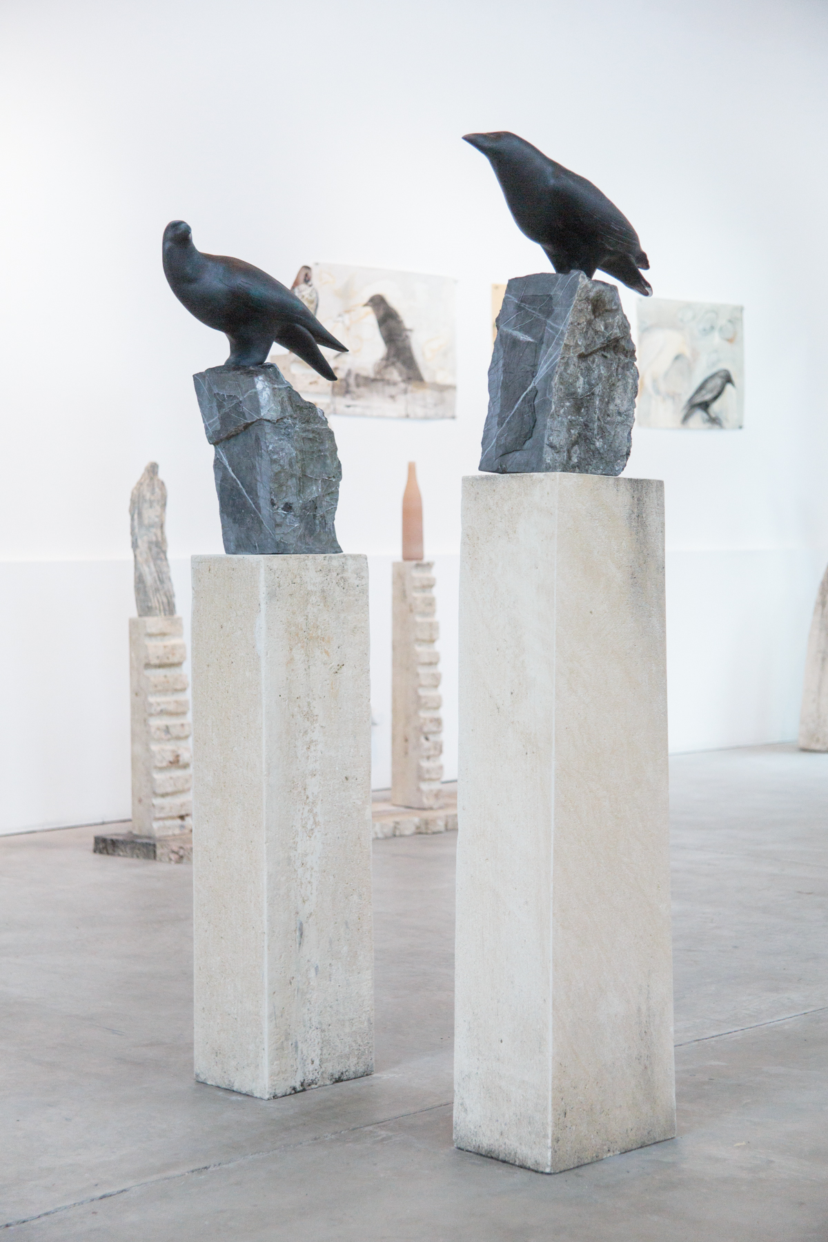 """Ravens (Male and Female),"" 2018 Hand blown pigmented glass, marble and limestone  60 x 8 x 16 inches (Female) 63 x 8 x 15 inches (Male)"