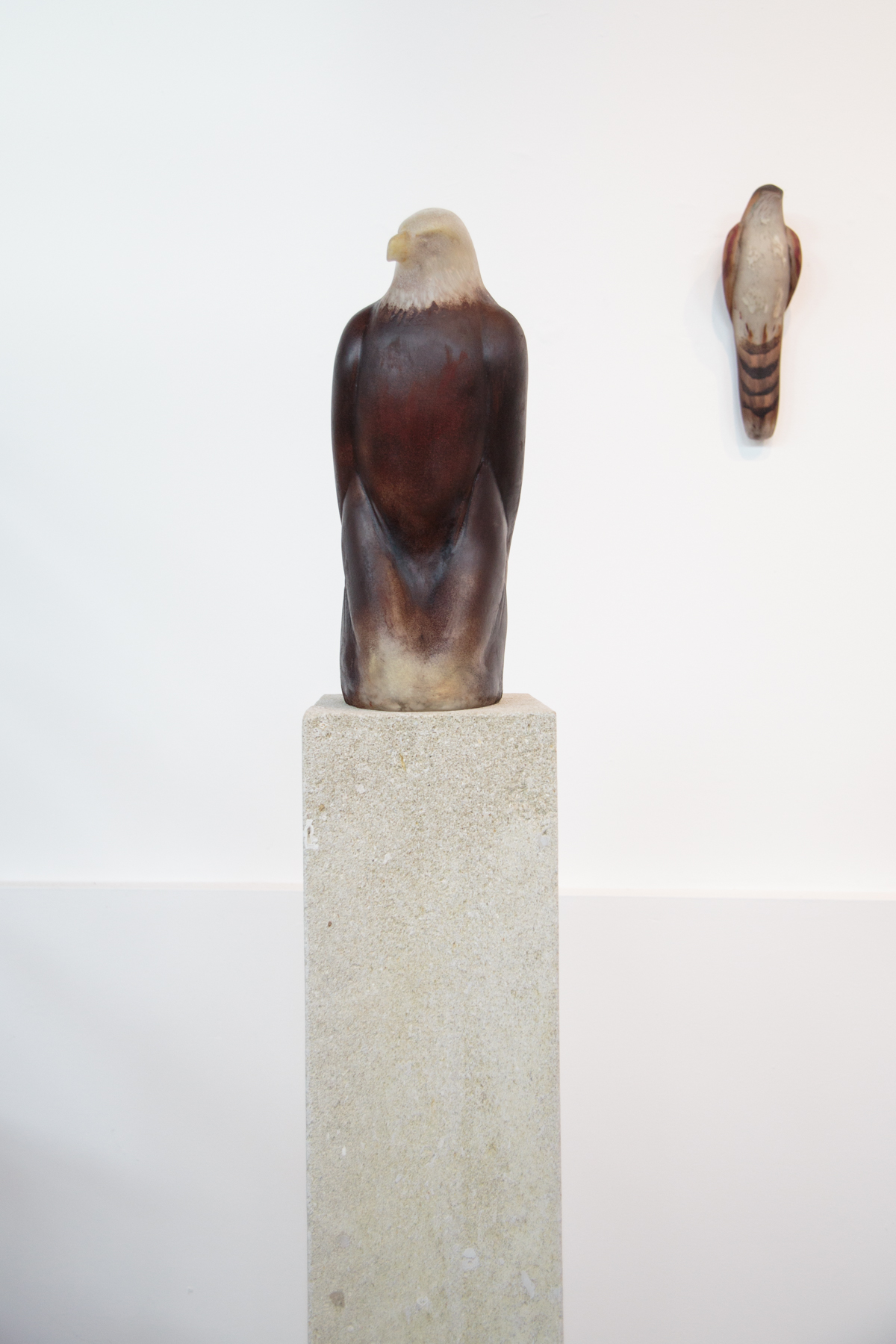 """Eagle,"" 2019 Handblown pigmented glass on limestone  62.5 x 8 x 11 inches"