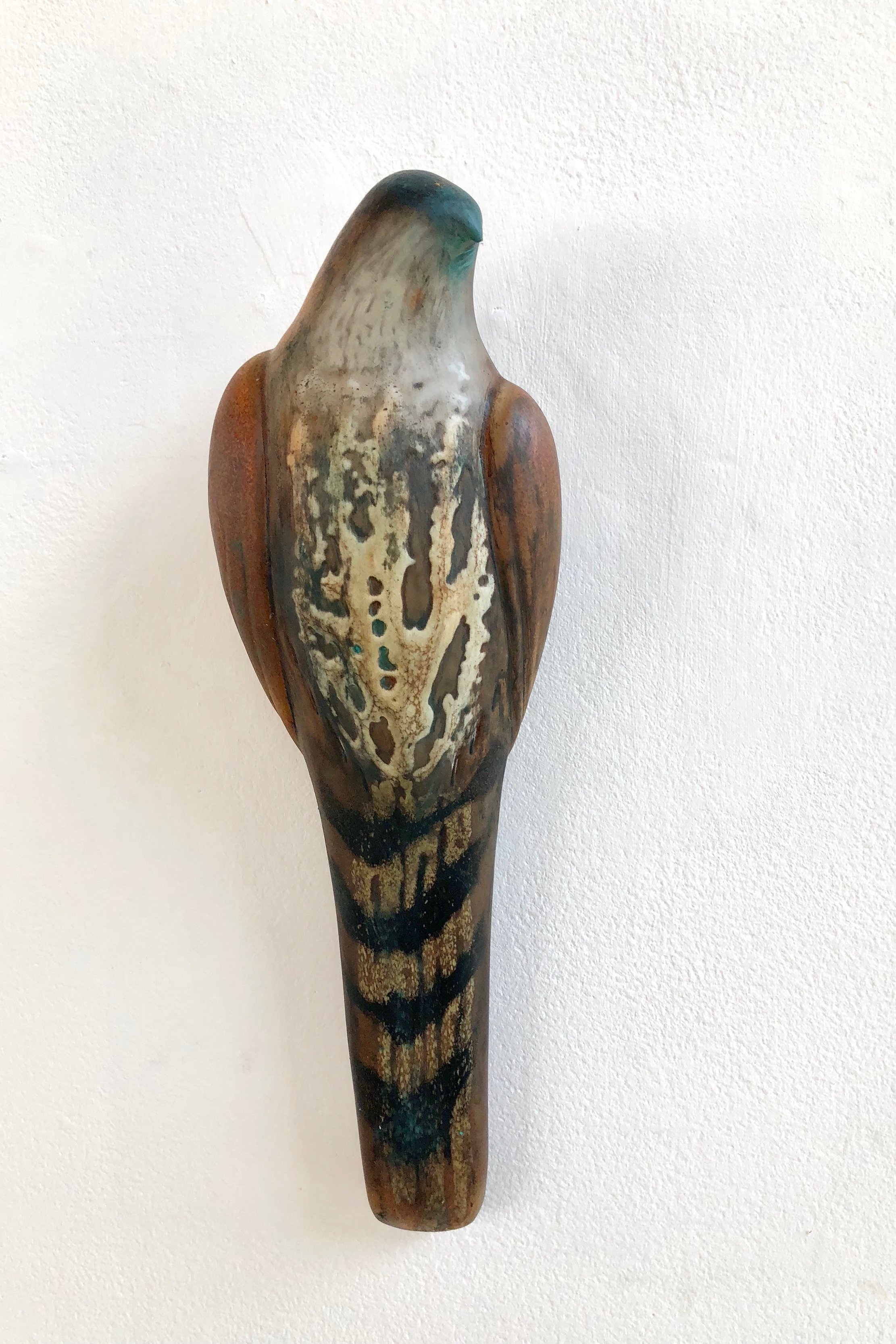 """Sienna Lace Chest Bird,"" 2019  Handblown pigmented glass 16 x 3 x 5 inches"