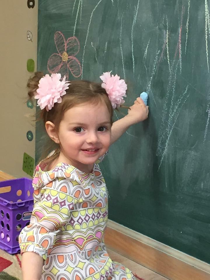 girl on chalkboard.JPG
