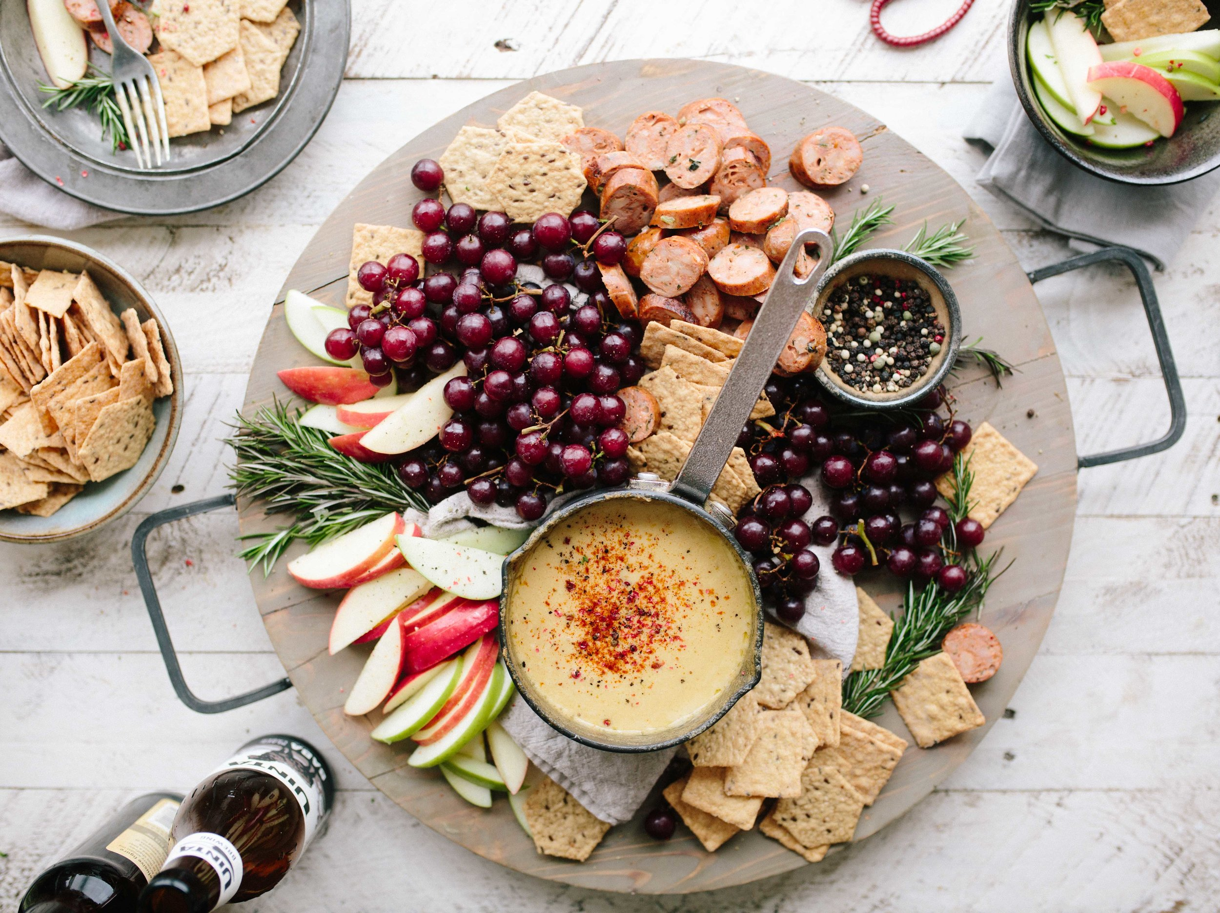 Bring a simple but beautiful fruit and cheese plate to your party. Add some low-sodium crackers and sliced baguette with some grainy mustard for extra flavor options.
