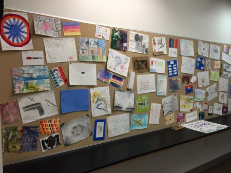 """Part of a display of the pieces that students created in the """"Strange/Familiar"""" project."""