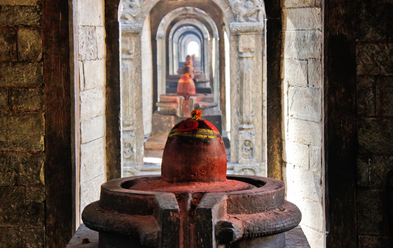 Yoni and Lingam in Pashupatinath Temple. The  Lingam  and  Yoni  represent the inseparability of male and female principles and the totality of creation.