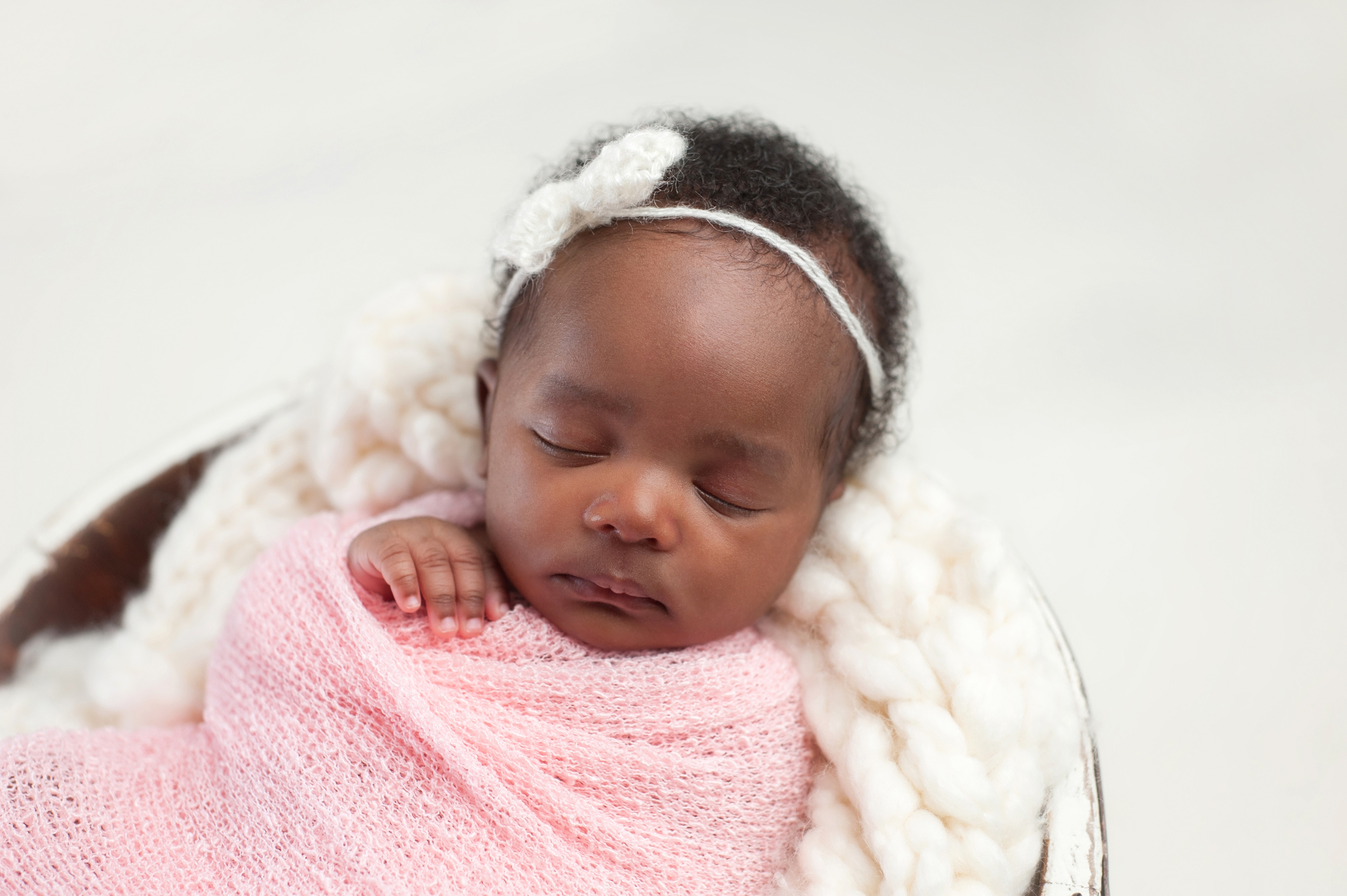 black baby in a pink blanket