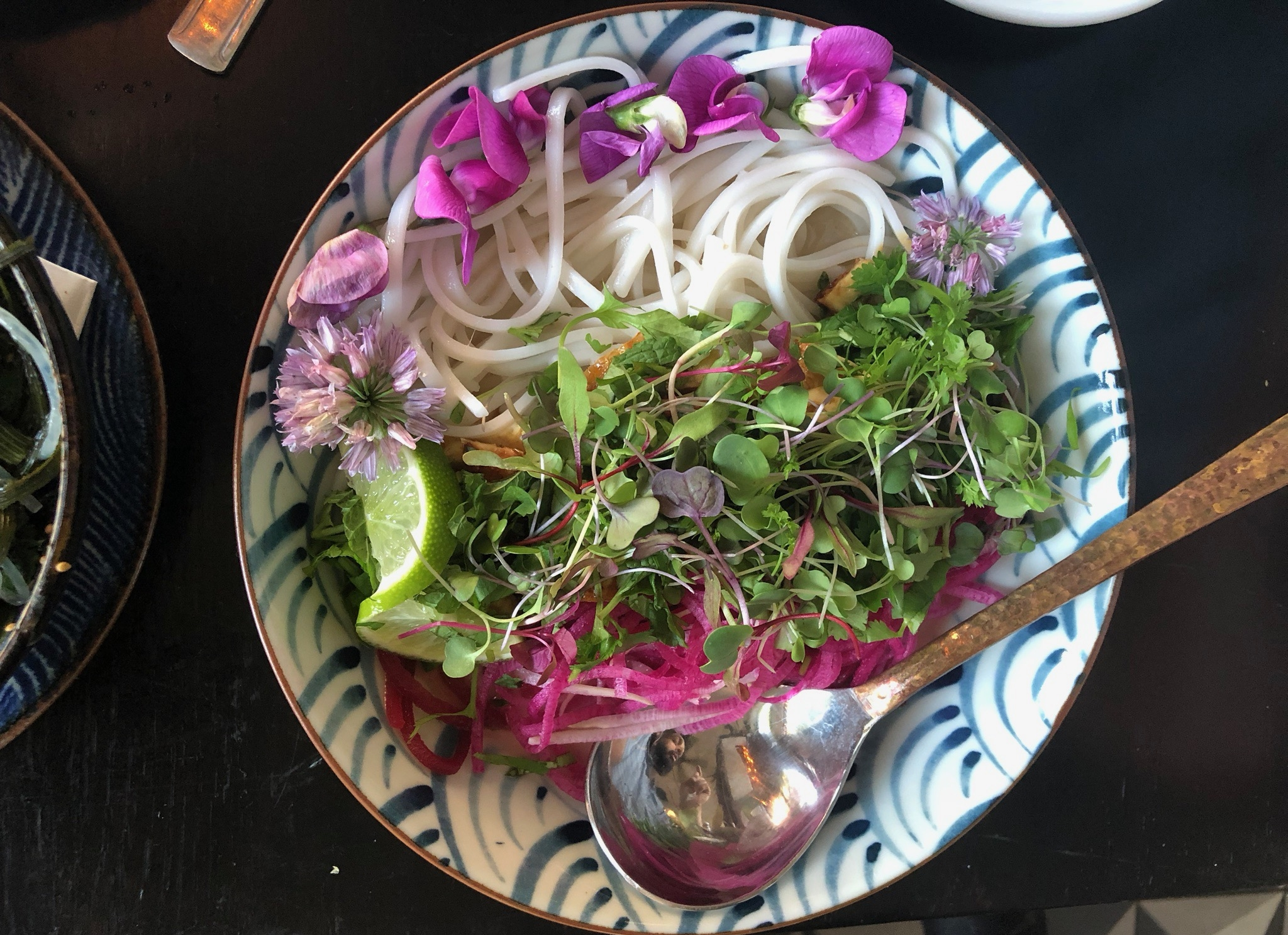 pink moon  - rice noodles / beet + radish spirals / kaffir lime + ginger coconut broth / chili tofu / seasonal herbs and blossoms