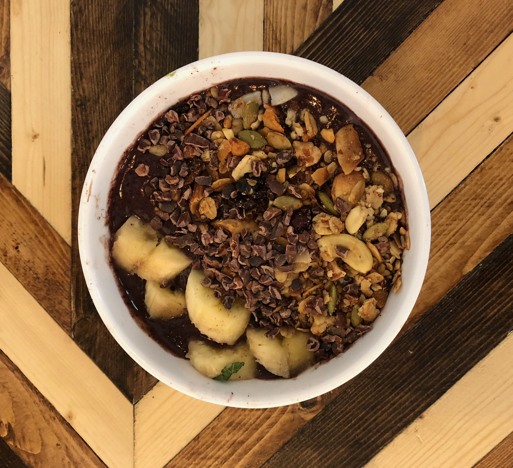 nutty nib smoothie bowl - banana +blueberry +almond butter +cacao +acai +agave / topped with banana +granola &coconut flakes