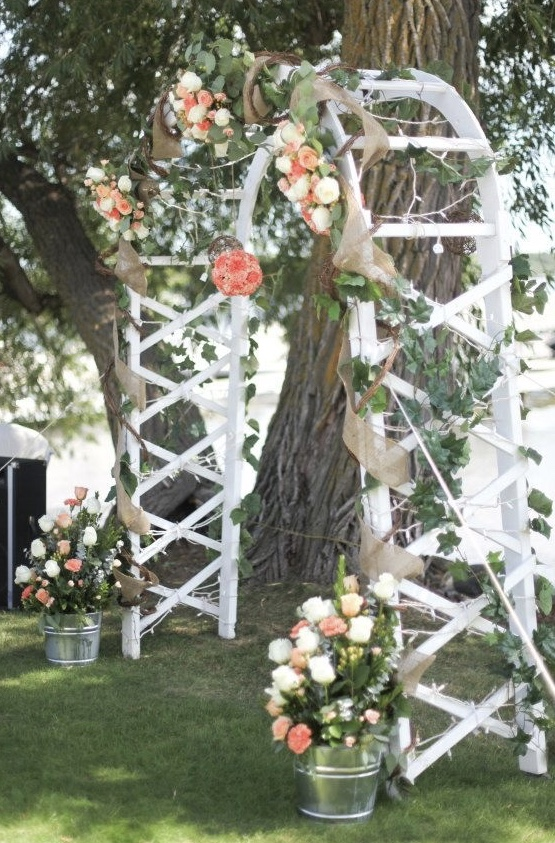 Alter floral designs with archway