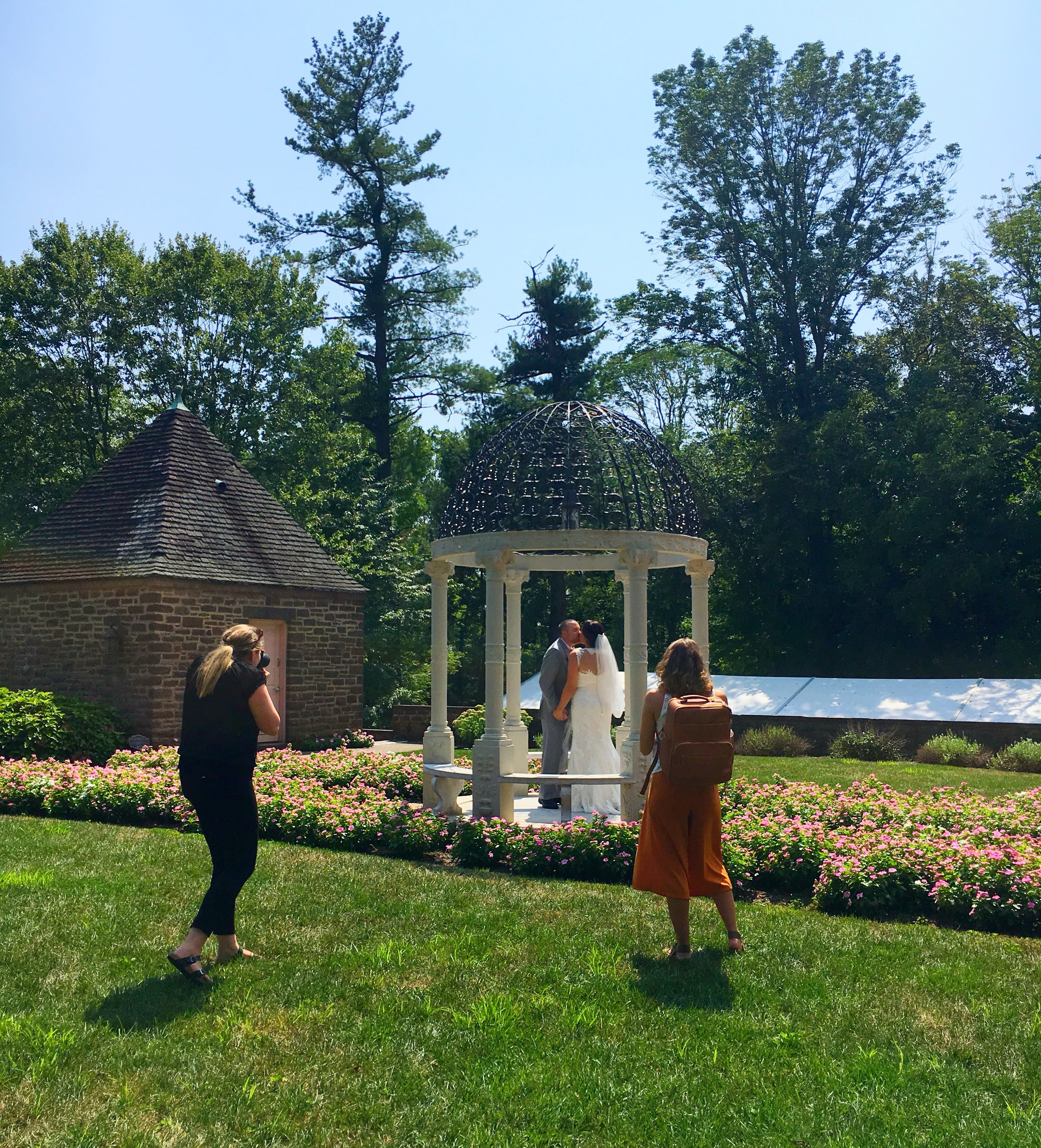 Photo of Videographer: Hannah Marie Film & Photo (to the right) and Photographer: Karen Ann Photography (to the left) capturing this beautiful couple at Tyler Gardens in Newtown, PA