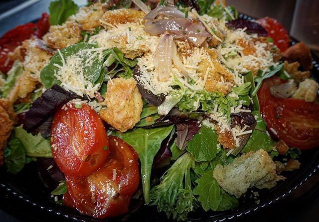 Organic Mixed Greens with Roasted Tomatoes, Caramelized Shallots, Parmesan Reggiano, Garlic Croutons, and Wildflower Honey Vinaigrette