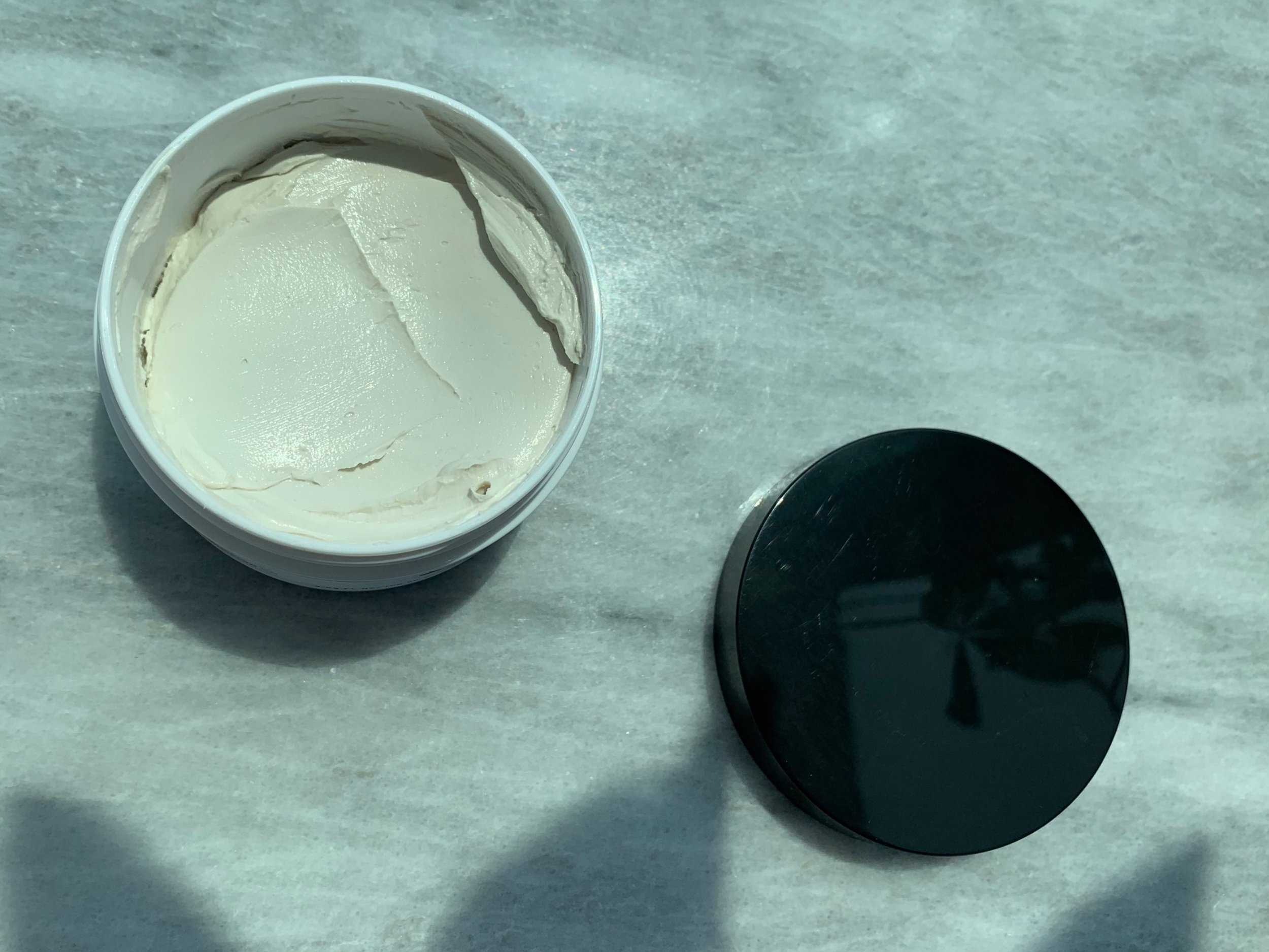 The Mxt. x Carmine Luminous Clay Mask is powered by 5 AHAs as well as Salicylic Acid and Bromain.