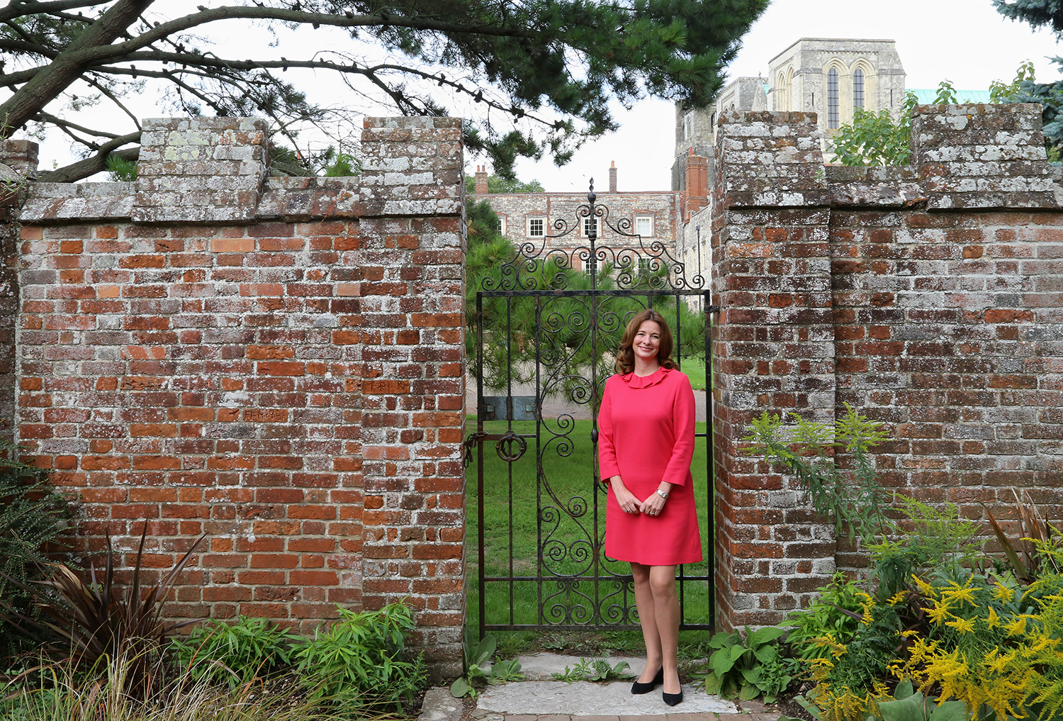 Gillian Keegan MP in Bishop Palace Gardens, Chichester with Chichester Cathedral in the background