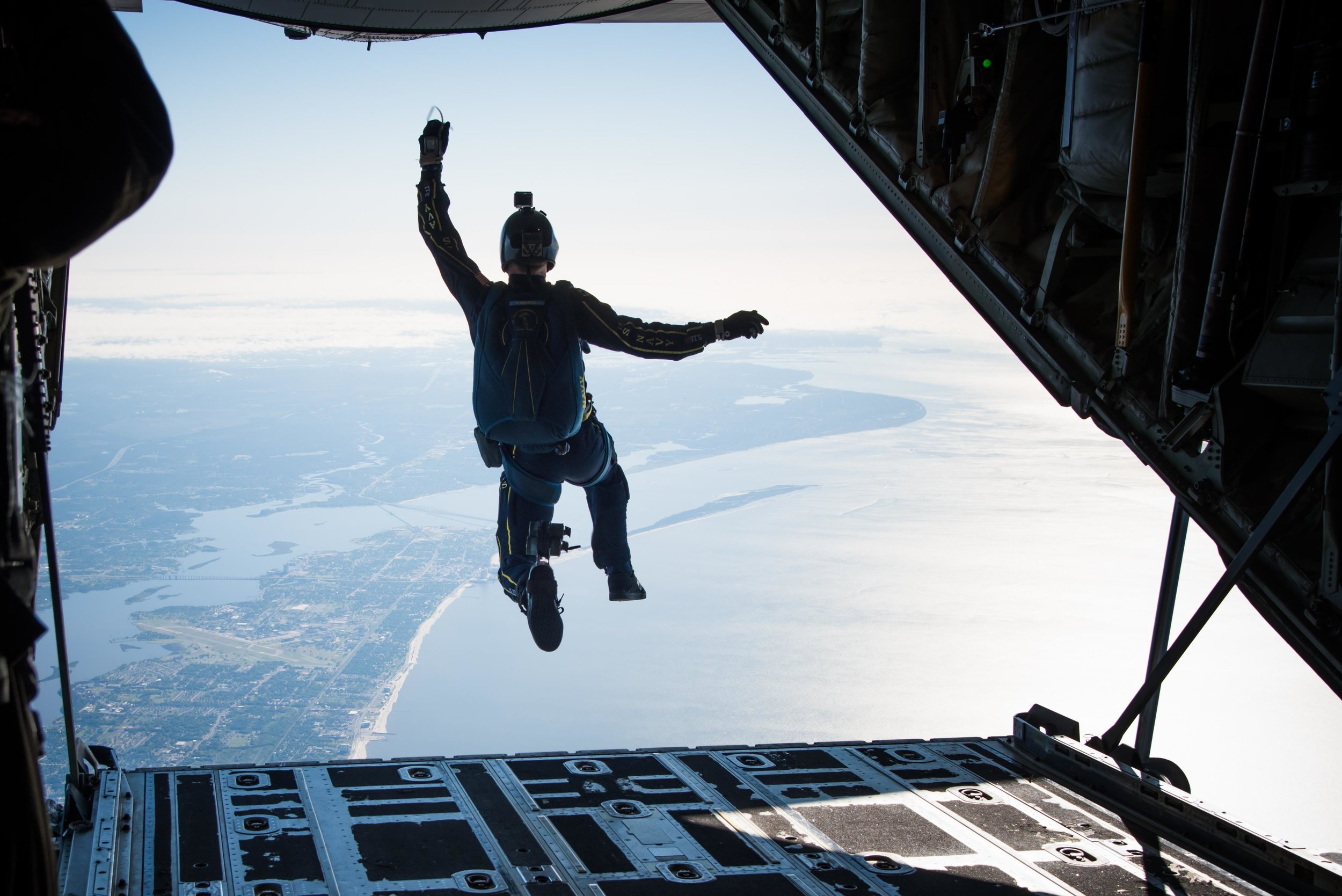 Last year I had the opportunity to fly with the Air Force Reserve's 815th Airlift Squadron Flying Jennies and the U.S. Navy Leap Frogs for a training mission and demonstration for part of the Mississippi Gulf Coast's Navy Week. This photo pretty much sums up how I felt to be able to take this photo.