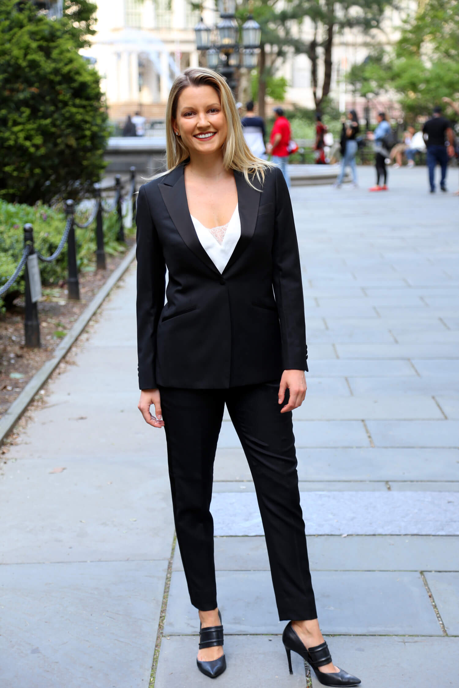 Christina in a groomswoman tuxedo.