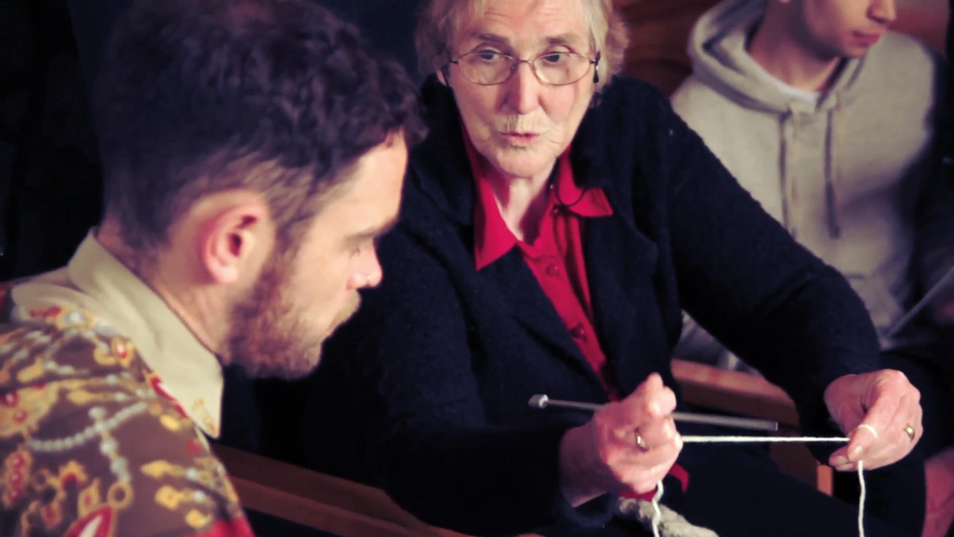 Still from Ishka Films documentation of DE14, showing Maireád Uí Fhlátharta's knitting workshop