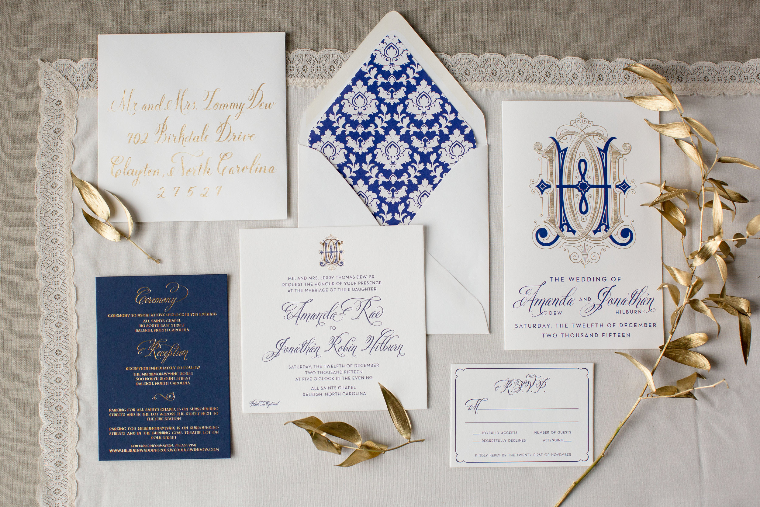 Amanda & Jonathan's custom invitation suite, featuring an interlocking monogram, navy letterpress and gold foil - stunning!
