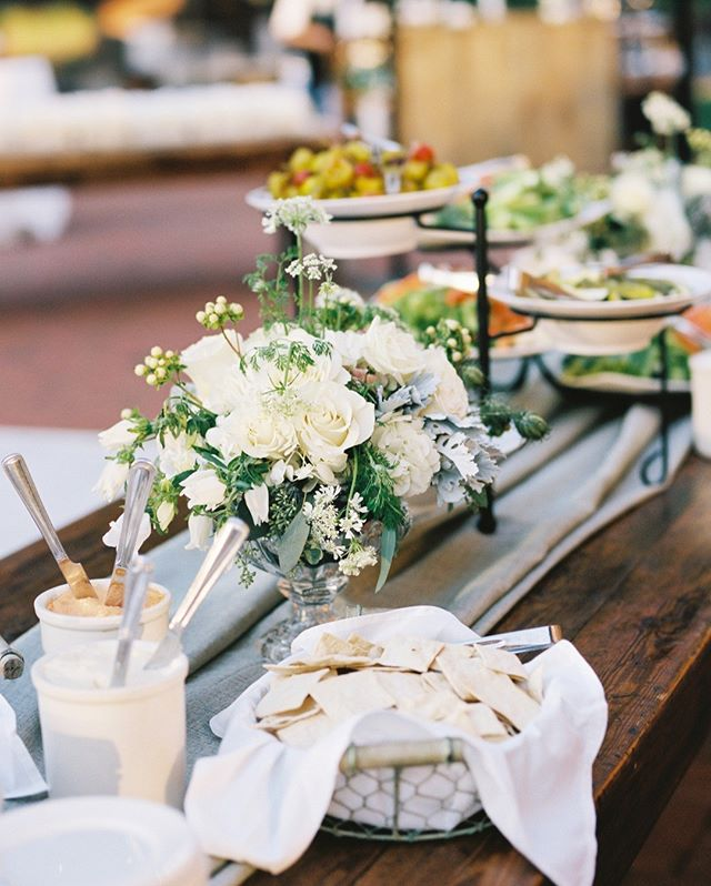 Weekend vibes: what could be better southern hospitality than @angusbarn's classic cheese, crackers, & crudité?  For Lindsay & Mac's wedding, we dressed it up on the patio with the softest florals and casually-draped blue-gray linen.  Welcome to the party! #gathertogetherweddings 📷 @anagramphoto