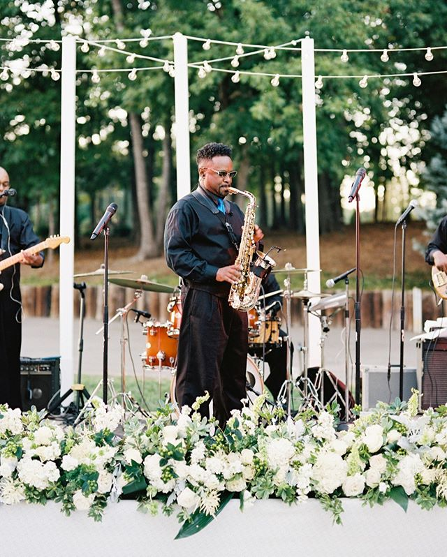 Insider tip: the band sounds better if the stage is covered in flowers 🌸🎶 #weddingtruths #gathertogetherweddings 📷 @anagramphoto