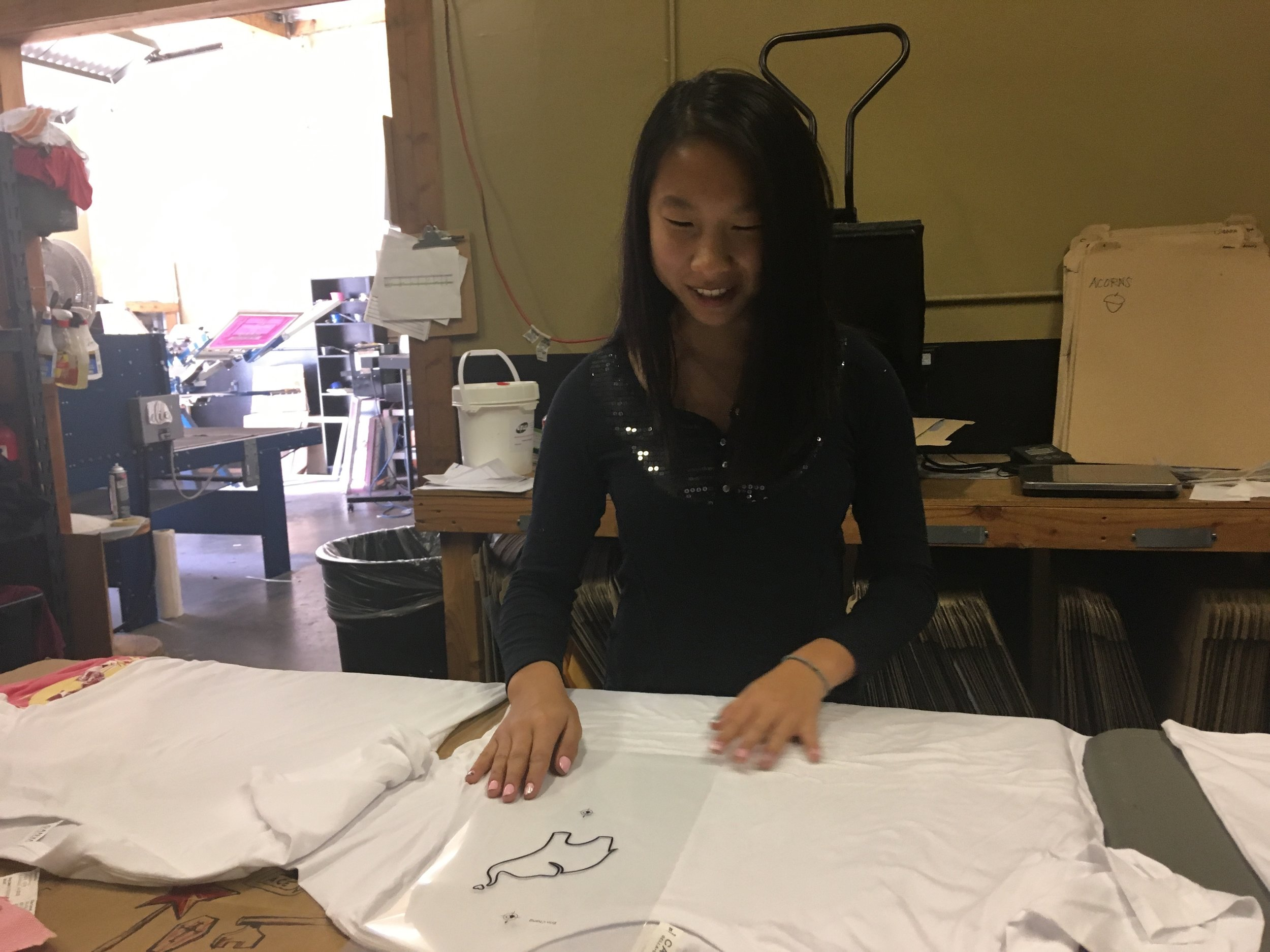 Erin setting the template for the shirt.
