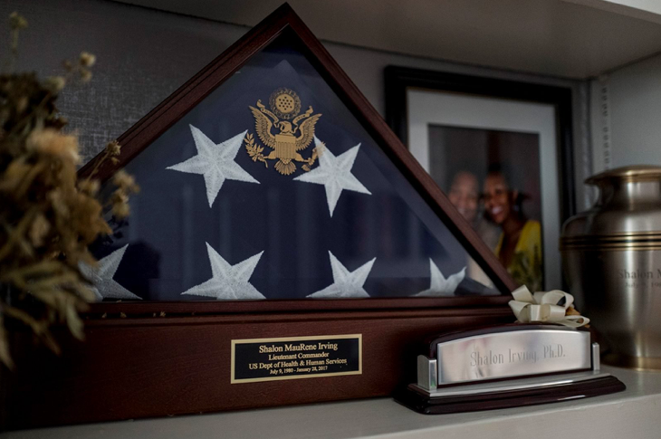 The flag that covered Shalon's casket is now in a memorial case with other mementos and photos (Sheila Pree Bright for ProPublica)