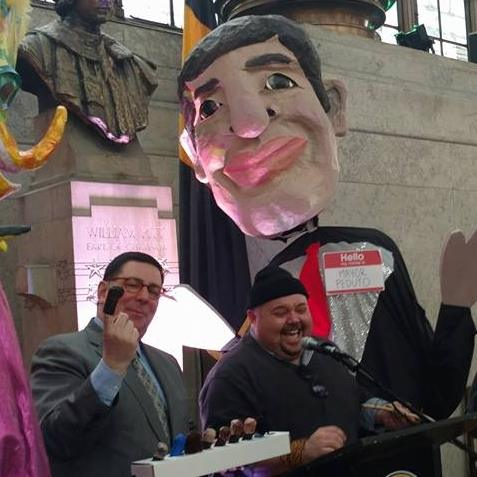 Pittsburgh Day of Puppetry 2018 - The spirit of the Pittsburgh Day of Puppetry is captured in this photo where Mayor Bill Peduto is wearing the finger puppet version of his city council nemesis and speaking to himself in her textured falsetto- while a much larger puppet mayor looms supportive in the background- all at the podium surrounded by a crowd of staffers, bystanders, and press members. This played out better than I could have imagined.
