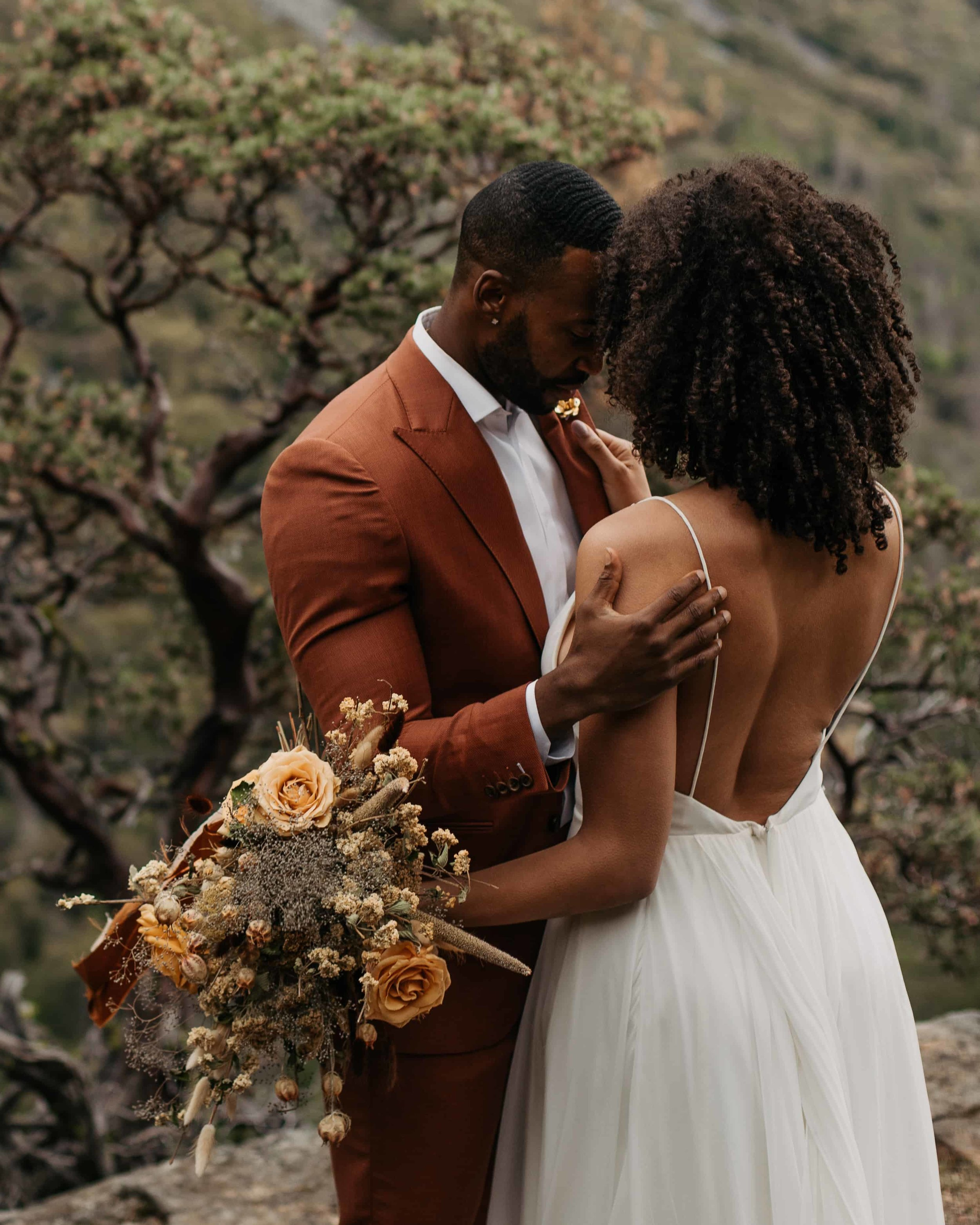 elopement couple giving us 5 reasons why we should elope based off of how they look at each other