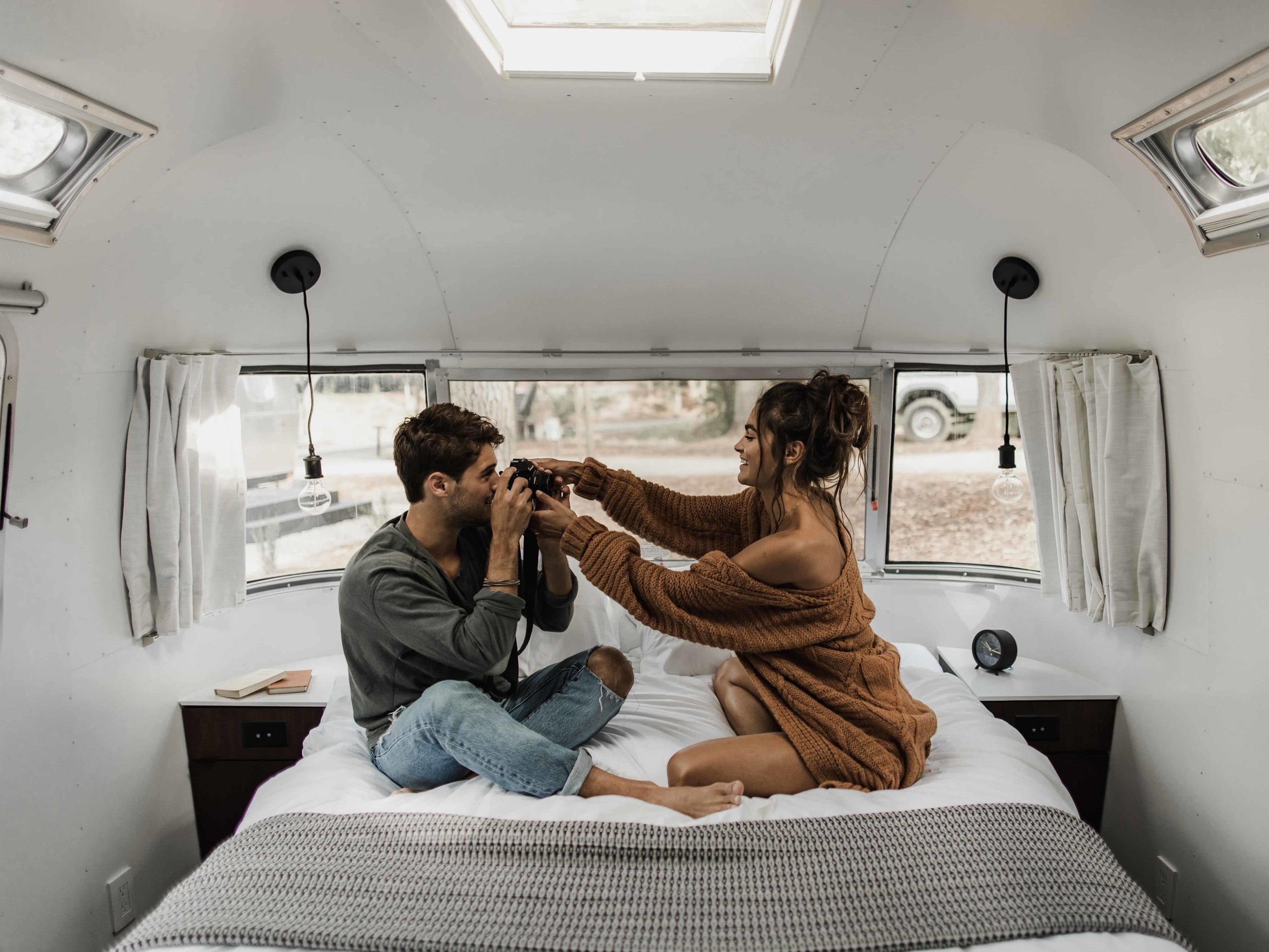 couple in an airstream before their mountain elopement
