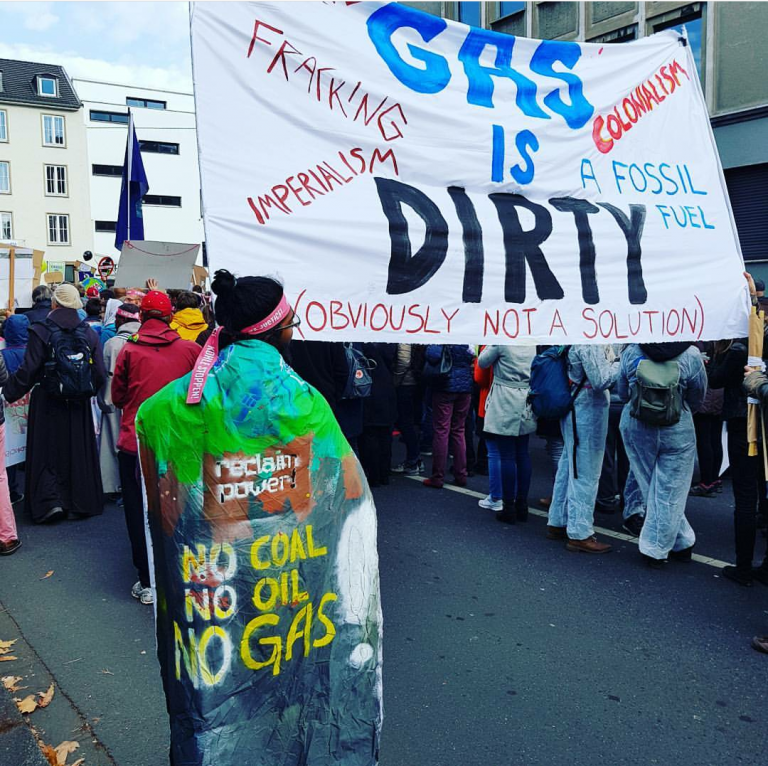 Amalen wears his No Coal No Oil No Gas cape at a second Climate March in Bonn