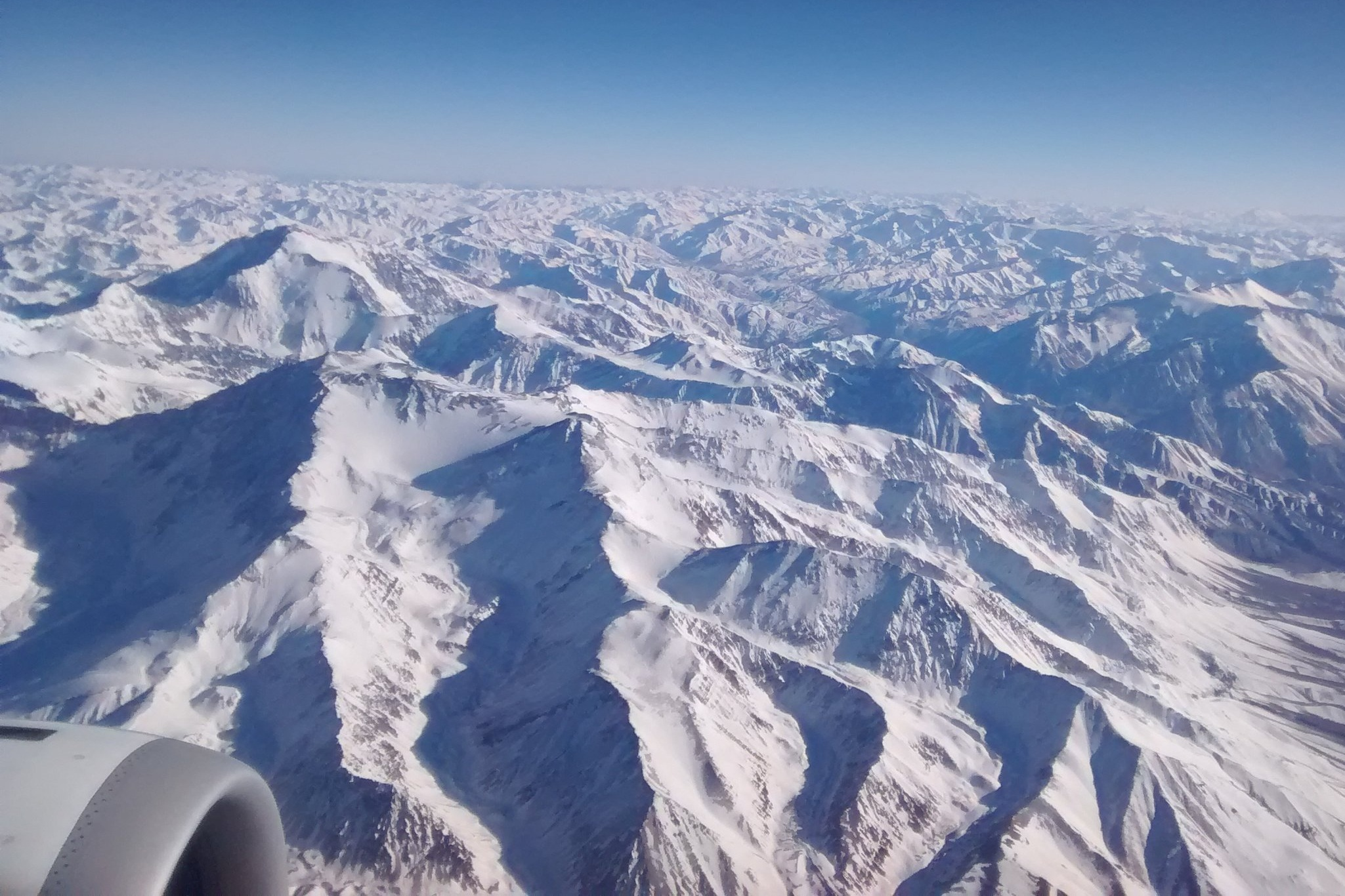 Flying over the Andes Mountains. In some areas, the snowcaps are disappearing.