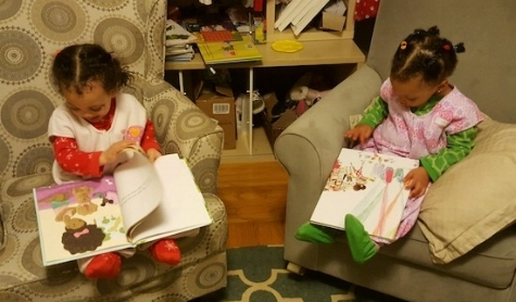 "Twin two-year-old girls ""reading"" Ada Twist and Big Hair Don't Care"