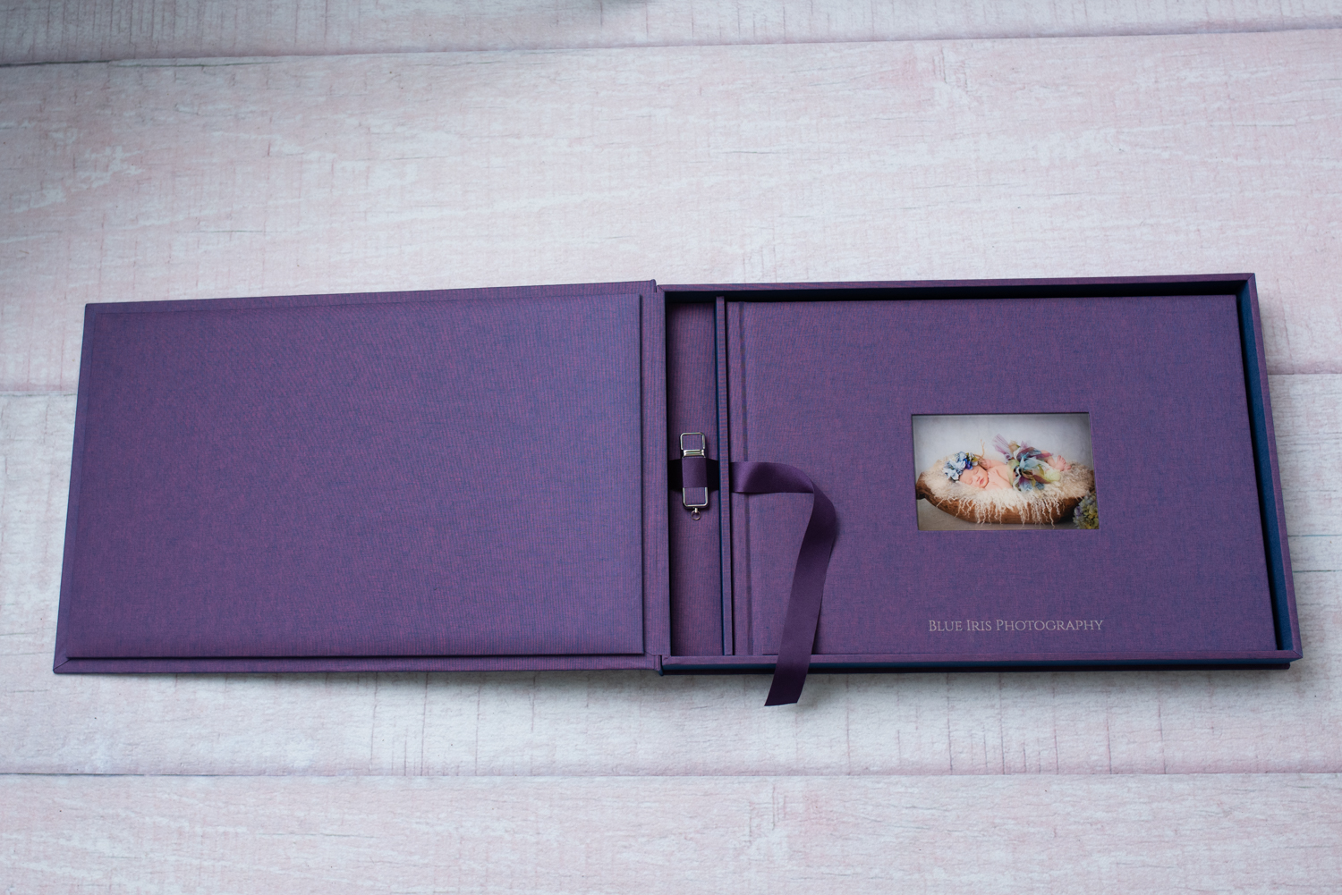 A 12x17 inch Photo Book Pro Set with handcrafted, customized cover comes with a matching keepsake box and flash drive.