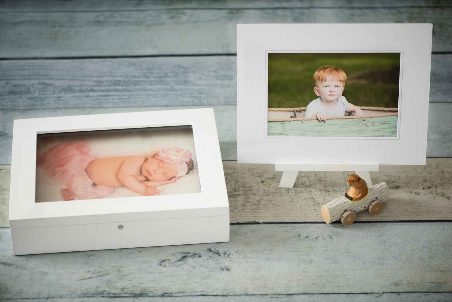 Our original 11x14 keepsake folio box, holds up to 25 fine art matted or mounted prints. Perfect for all of baby's first year portraits or your family's favorite portraits thru the years. Create special family time around the coffee table!