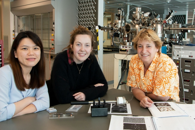 Left to right: Postdoc Shu Fen Tan, graduate student Kate Reidy, and Professor Frances Ross, all of the Department of Materials Science and Engineering, sit in front of a high vacuum evaporator system. The equipment was housed temporarily in MIT.nano while Ross's lab was built out in Building 13.   Photo: Denis Paiste/Materials Research Laboratory