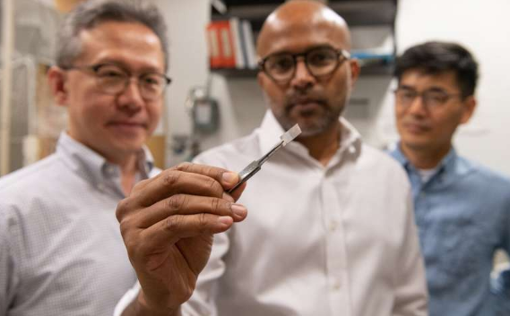 Seung Soon Jang, an associate professor, Faisal Alamgir, an associate professor, and Ji Il Choi, a postdoctoral researcher, all in Georgia Tech's School of Materials Science and Engineering, examine a piece of platinum-graphene catalyst. Credit: Allison Carter