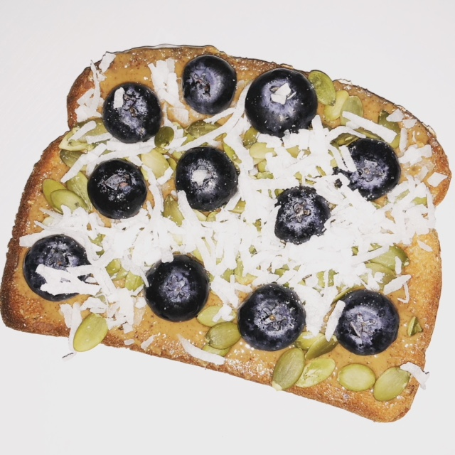 Pumpkin Seed Toast - 1 piece of whole grain or whole wheat toast1 tablespoon nut butter1 tablespoon raw, unsalted pumpkin seeds1-2 teaspoons coconut flakesHandful of blueberries