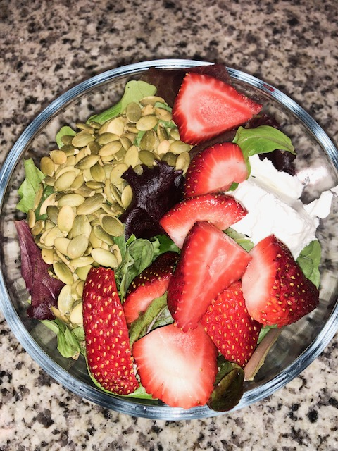 Strawberry Spring Salad - 1-2 cups of salad base such as Spring Mix2 tablespoons of pumpkin seeds1 tablespoon of goat cheese4-5 strawberries