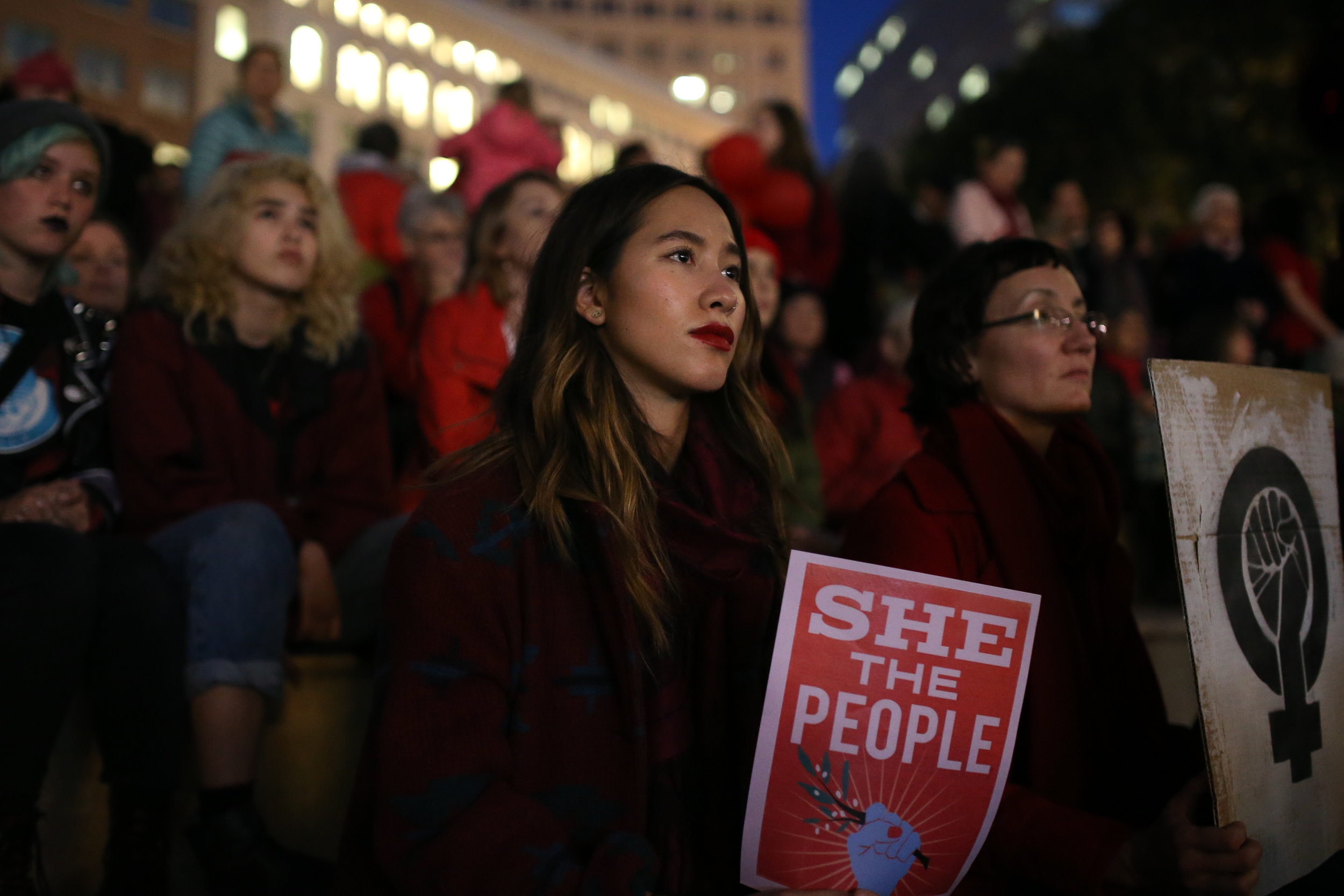 Women mark International Women's Day by attending a protest at City Hall in Oakland, California
