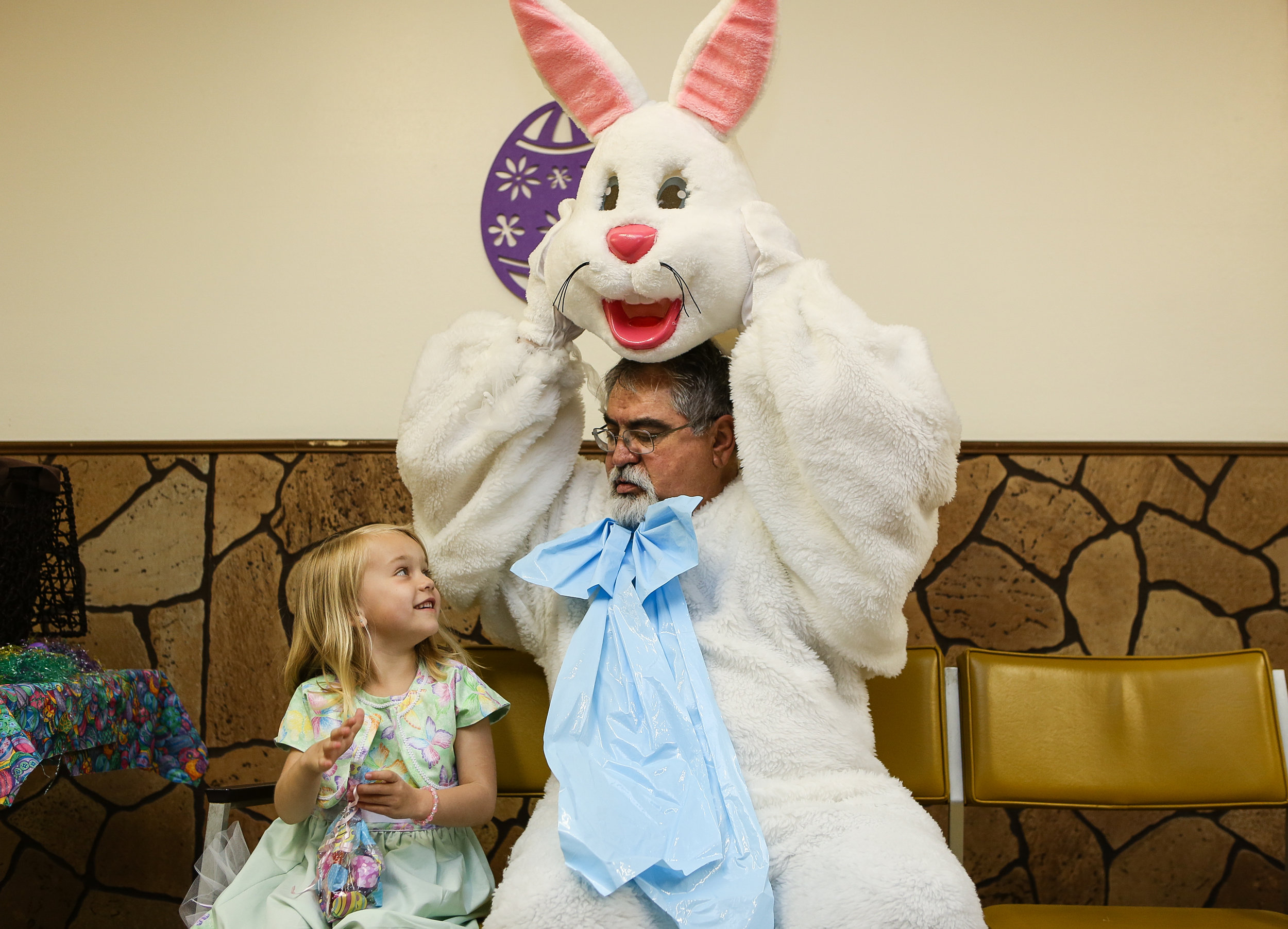 Katelyn Ragsdale shares a moment with Larry Lambert as the Easter Bunny in Ray, North Dakota
