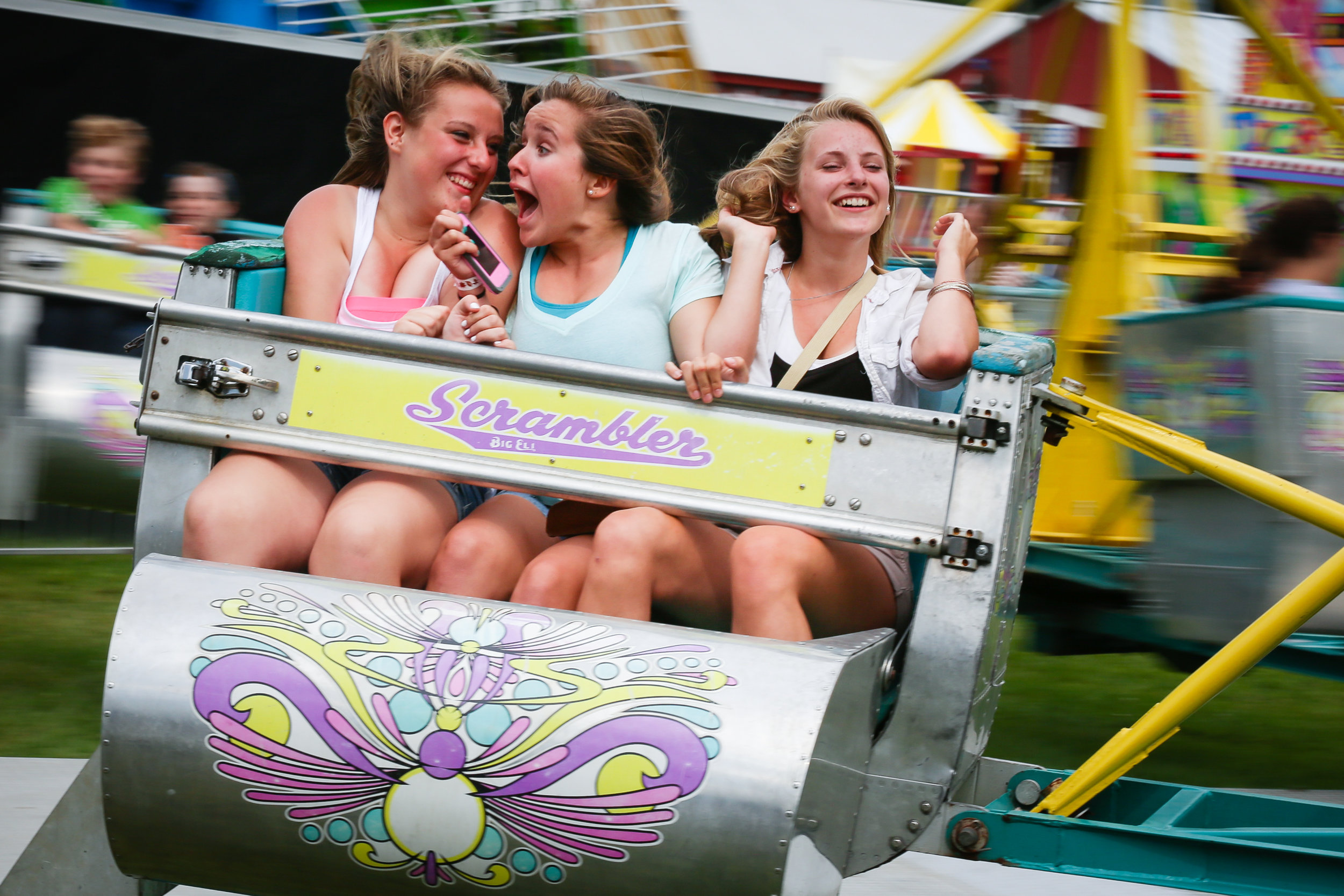 Sophie Hammond, Lily Hier, and Emily Bourne ride the Scrambler at the Cornish Fair in Cornish New Hampshire