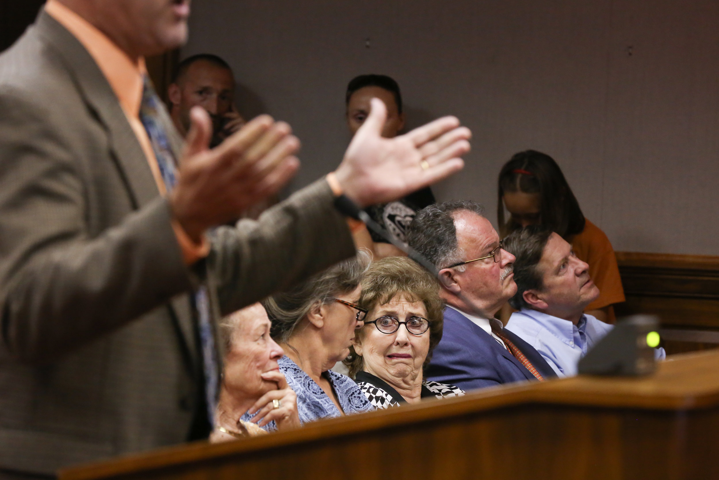 Raceway opponent Joyce Ackerman reacts to supporter Edwin Purdue during a public hearing in Spotsylvania County