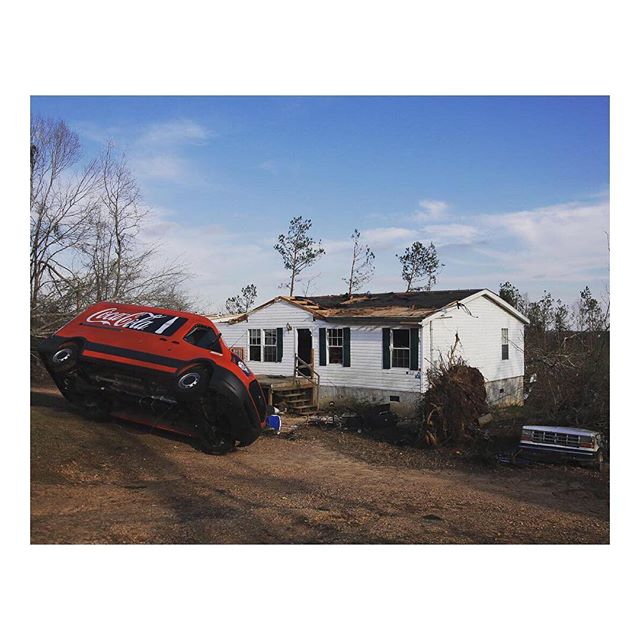 A Coca-Cola truck lays on its side against another car in the yard of a home damaged by a series of tornadoes that resulted in multiple fatalities. #onassignment for @reuters. Beauregard, Alabama. March 4, 2019. #beauregard #tornadoes #tornado #alabama