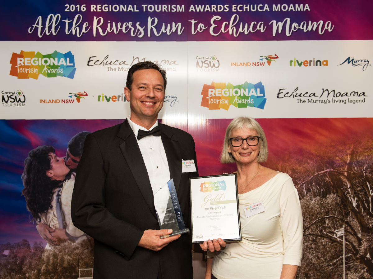 Alex (left) accepts Gold in the Tourism Restaurants and Catering Services category for The River Deck at the 2016 Regional Tourism Awards in Echuca Moama.