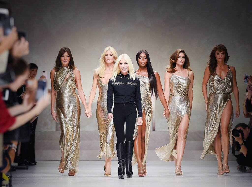 On the catwalk with her models.