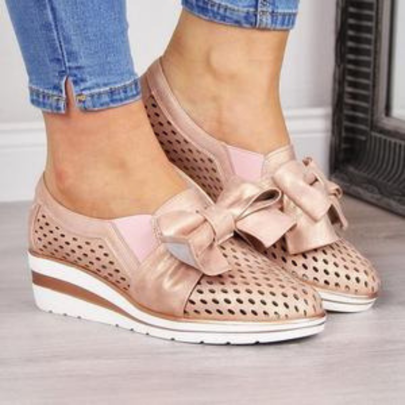 Soft pink with a wedge heel and a bow!
