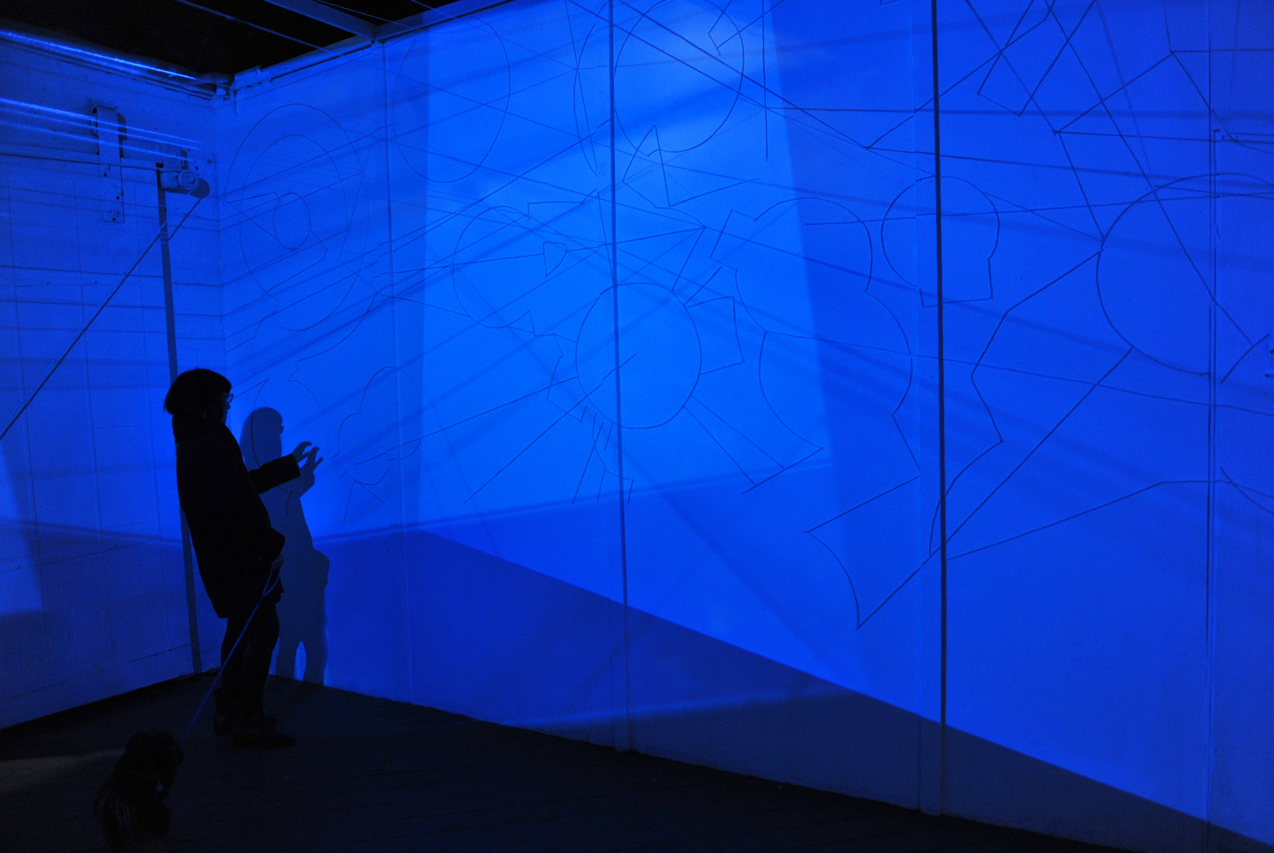 A Cielo Aperto #2   (2015), site specific 4 channels installation with plastic strings on walls, variable dimensions