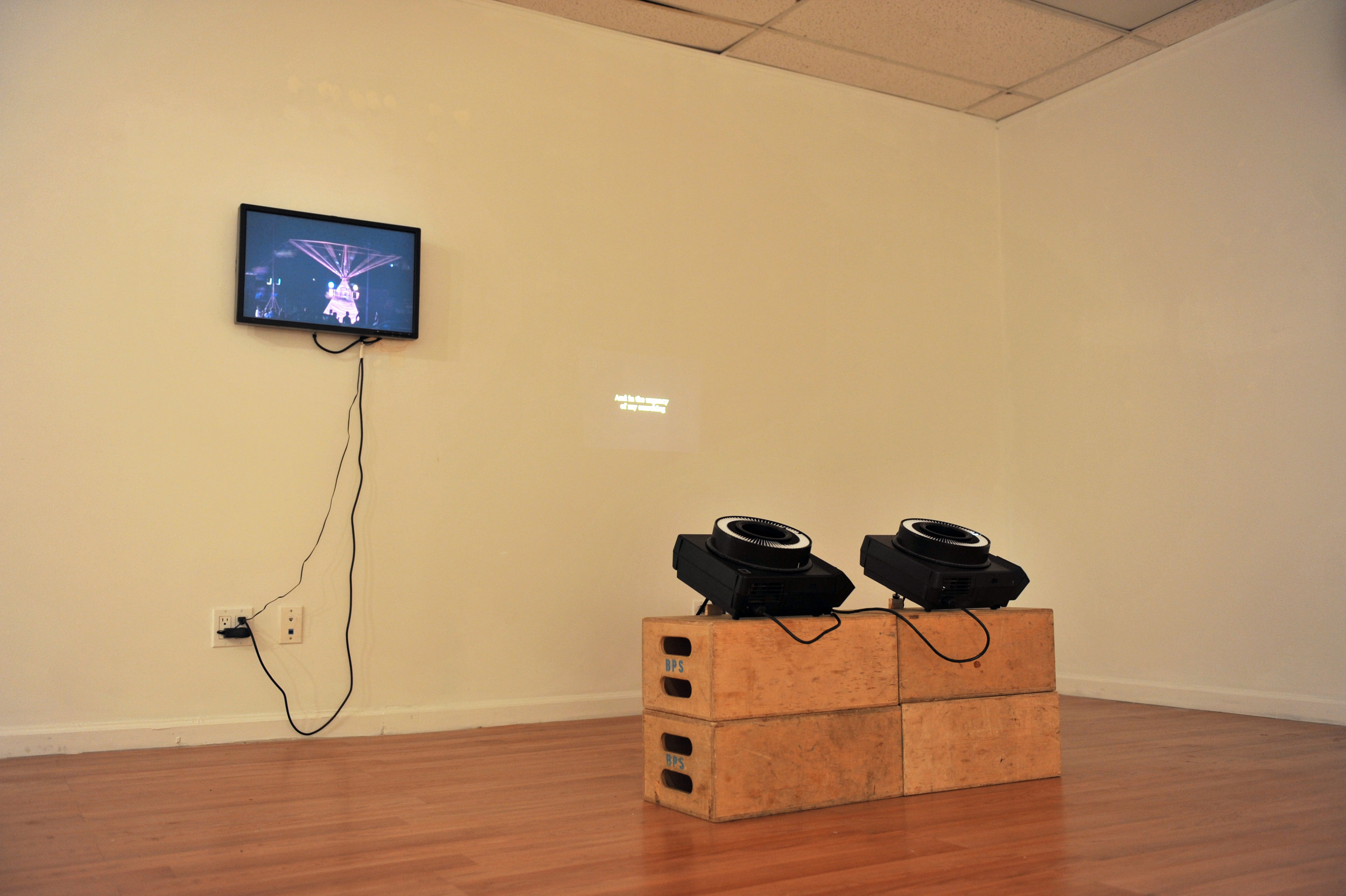 Load Displacement   (2012), one video and two dissolving slide projections