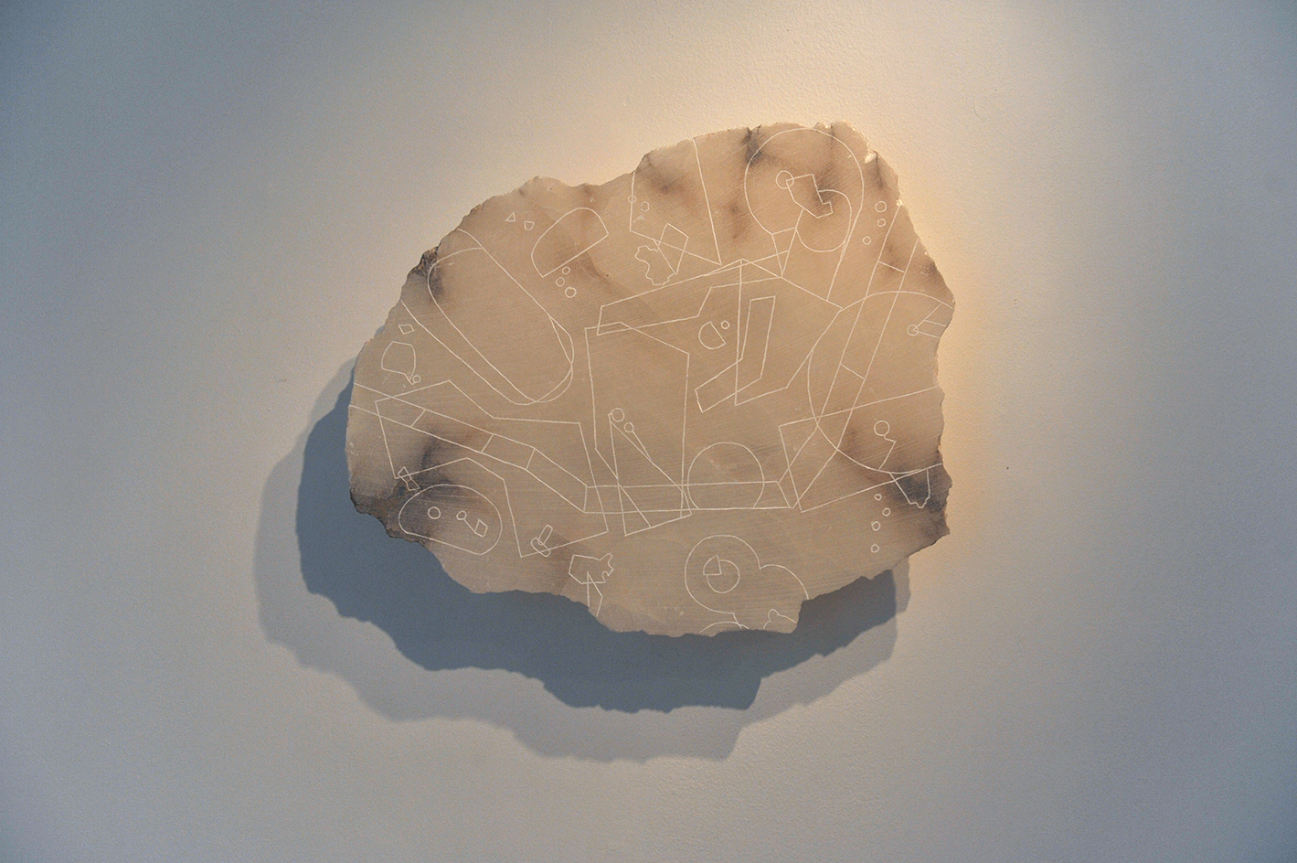 Low Flying Chart #1,  2016, carved alabaster slab depicting off-limits area of the Ligurian sky in Italy