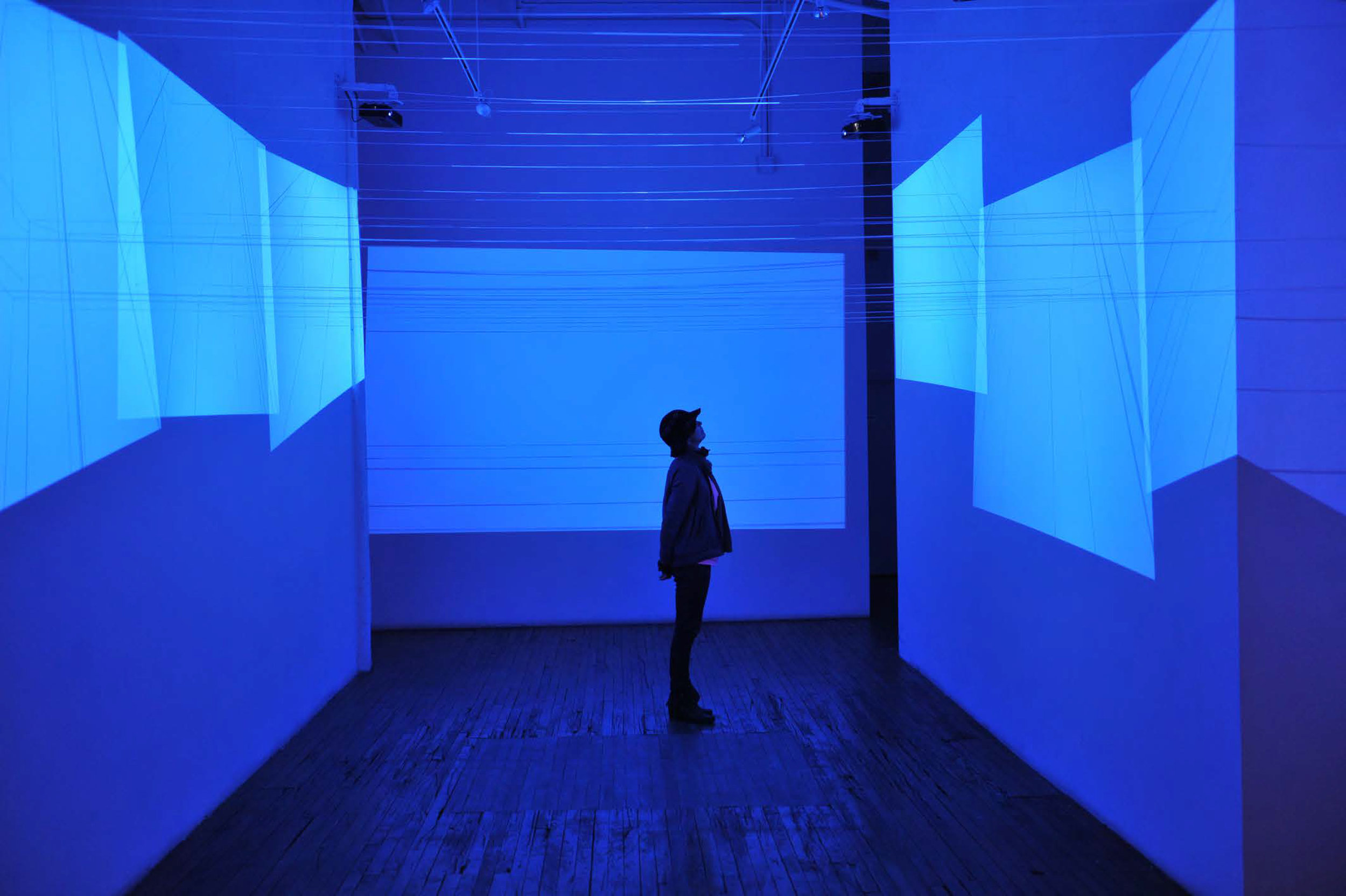 A Cielo Aperto #1,  2014 ,  Site specific 7 channels installation + plastic strings on walls, variable dimensions, ISCP, Brooklyn, NY